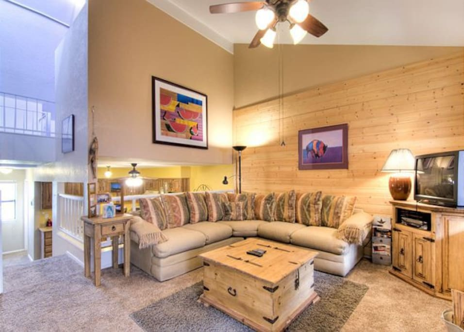 Large comfy family room ready for nightly 'smores in the wood burning fireplace.