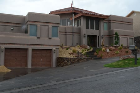 Spanish style mountainside home - House