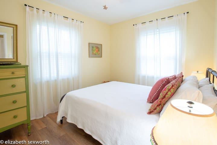 Guest bedroom has light and airy feel