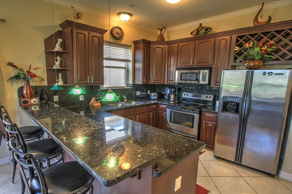 Granite counters, stainless appliances in the well-appointed kitchen