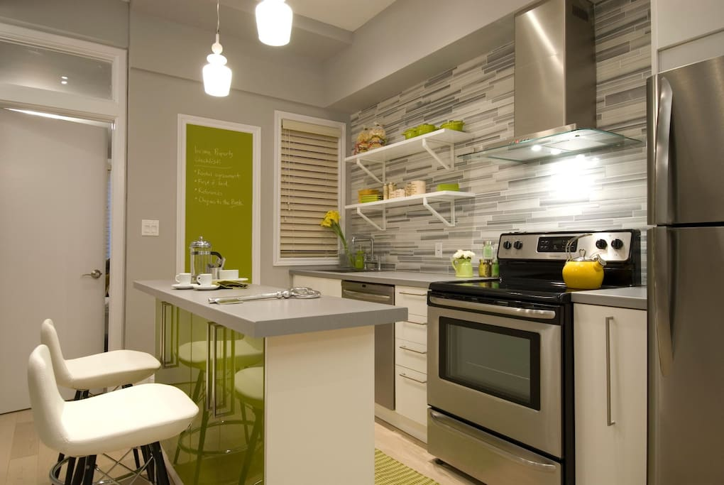 Fully equipped kitchen and bar area for cooking and socializing.