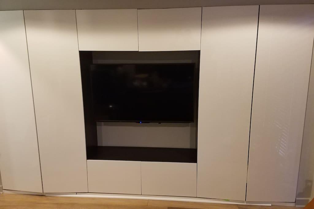 "50"" TV in master bedroom, closet space"