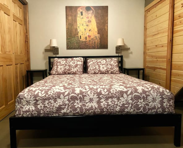 Comfortable queen-size bed with adjustable reading lights.