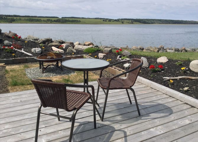 """Guests can enjoy their """"private"""" patio overlooking the harbour"""