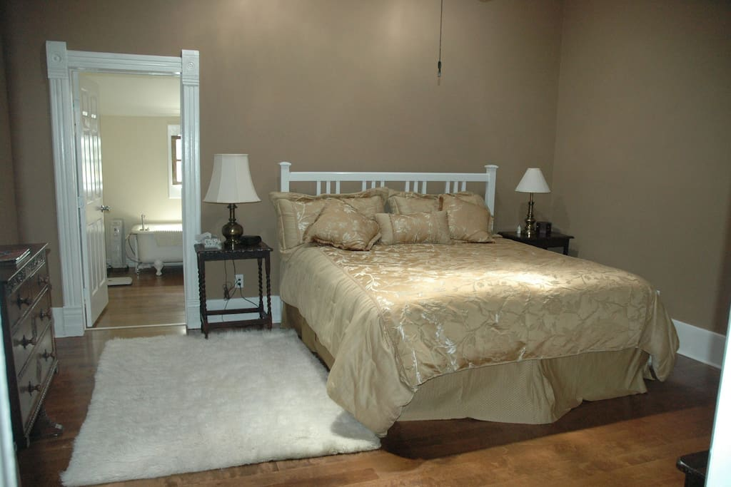 Master Suite.  King size bed.  Bathroom has claw-foot tub and walk-in shower.