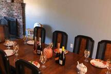 Dining room table that awaits you with a champagne bottle and wine