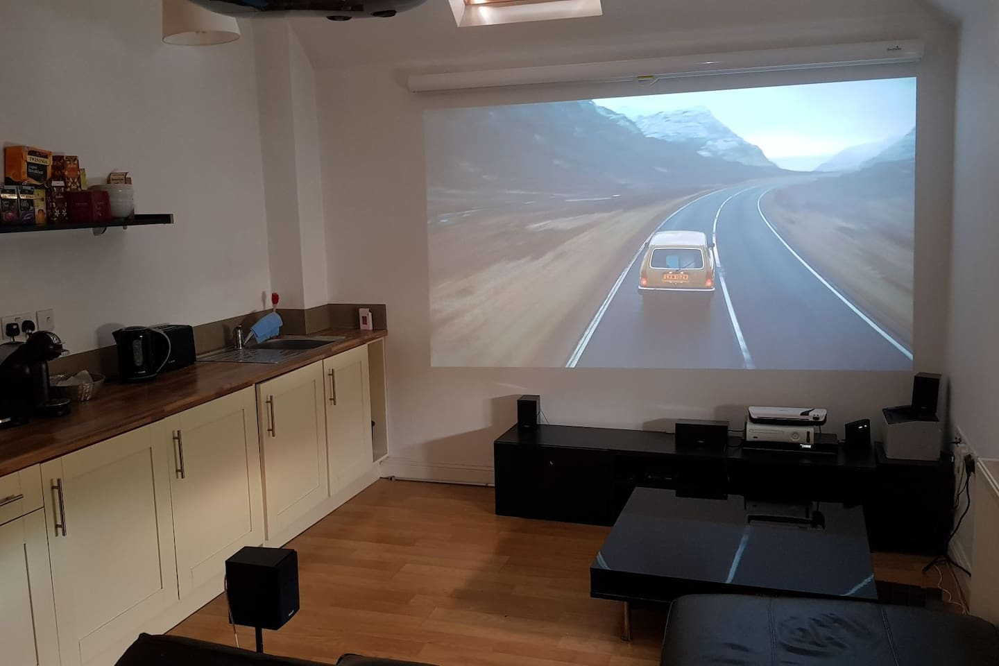 Lounge/kitchen area and projector