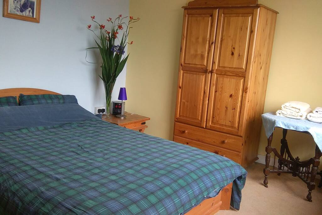 Garden View is a carpeted bedroom with a solid hard comfortable bed, you will sleep like a baby
