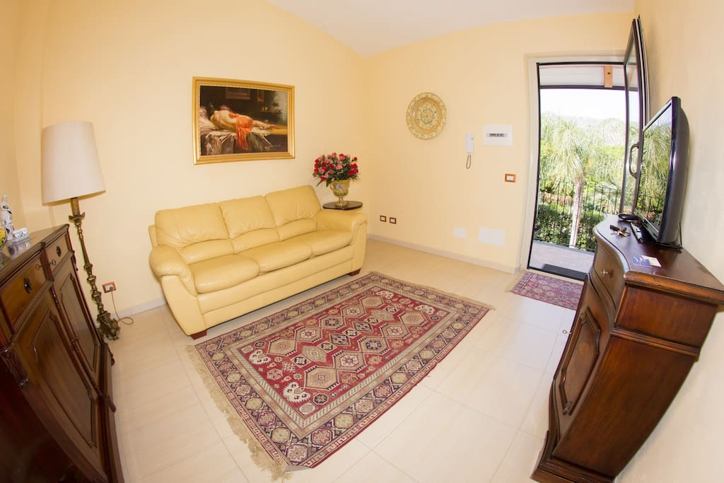 Living room with Sat TV and double sofa bed - Suite Apt Lorena - AGRITURISMO ROSEMARINE -  SUNTRIPSICILY COM