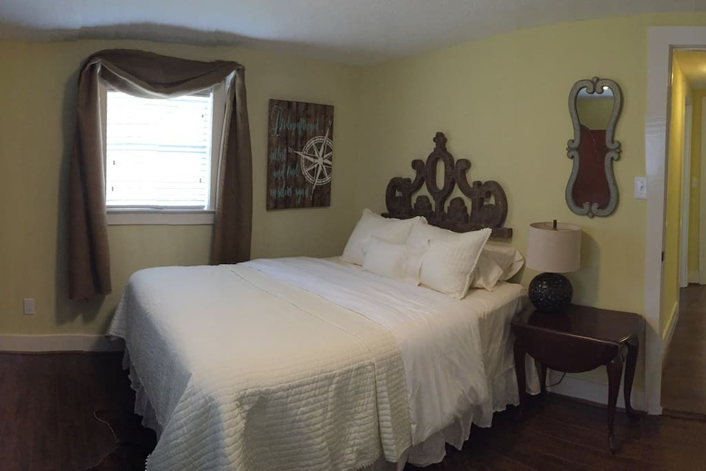 Main bedroom with queen bed and plush bedding.