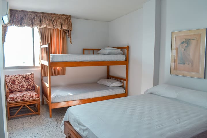 2nd Bedroom: Twin bunk beds and a queen bed