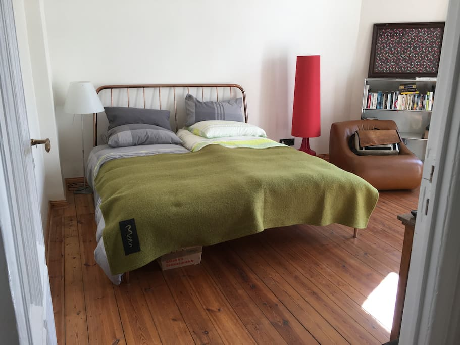 king size bed, old wooden flooring