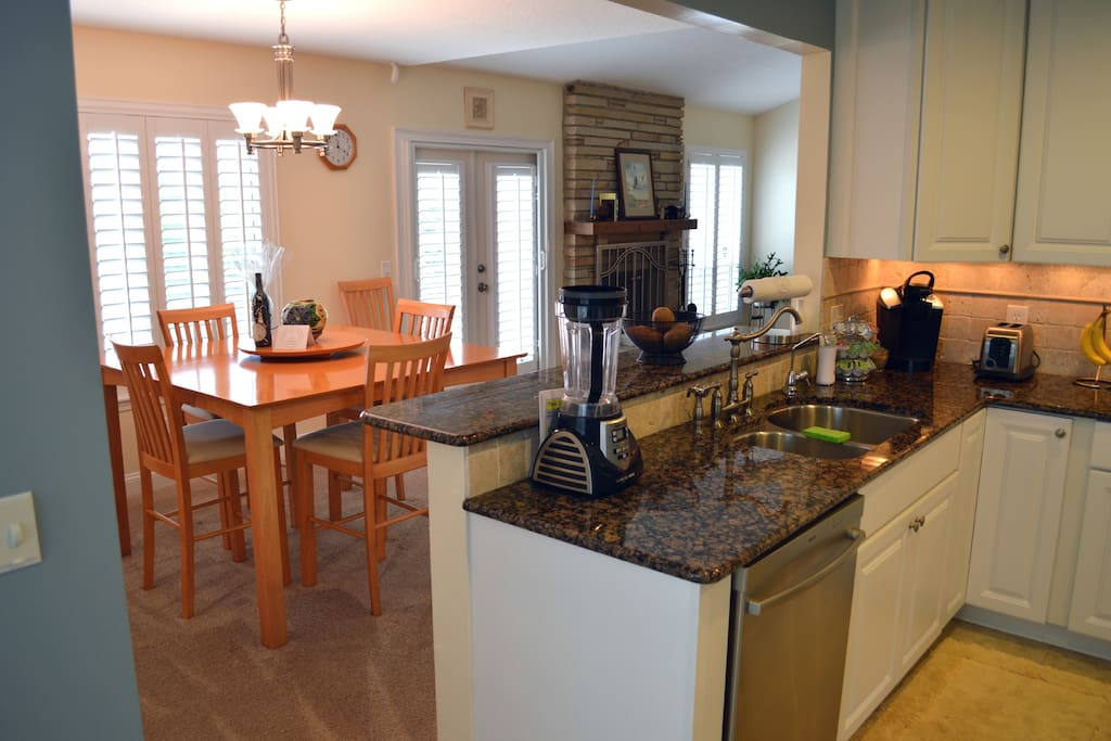 Upgraded, fully equipped kitchen overlooks the dining area, both with a marsh view.