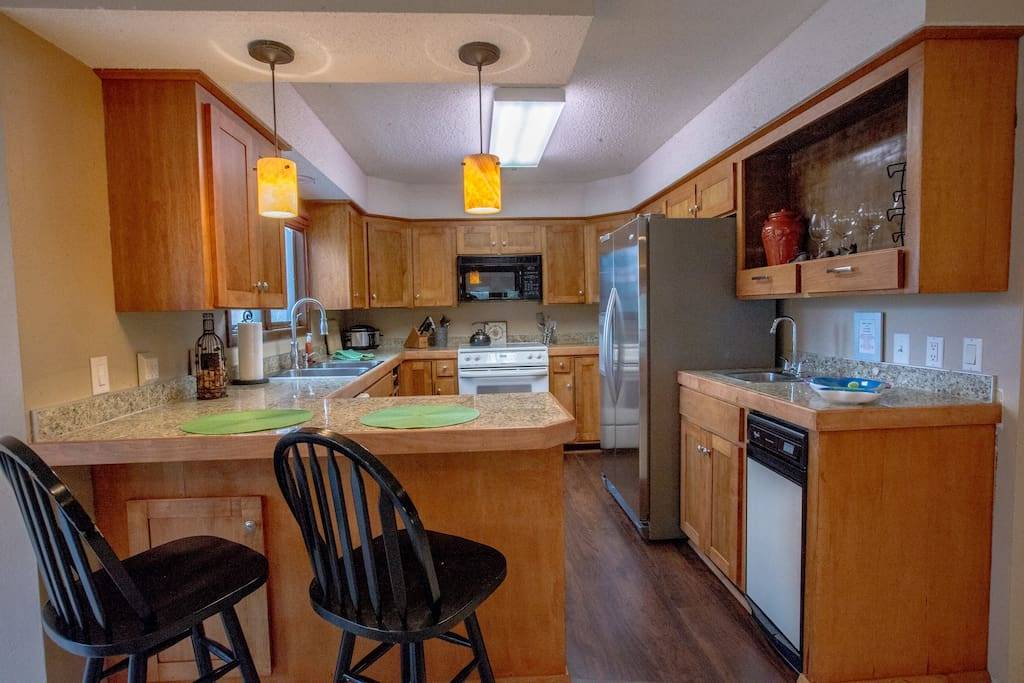 The fully equipped Kitchen opens to the Living Area. Dinnerware for 8 plus all the pots and pans you will need for your stay.