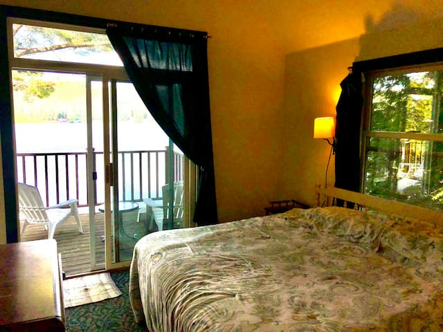 Main bed, 2nd floor, opens to deck, ceiling fan.
