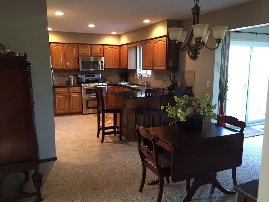 Kitchen and dining area with breakfast nook.