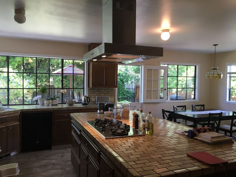 Spacious kitchen with gas burner, dish washer, oven, micro and BBQ on the deck to private back yard.