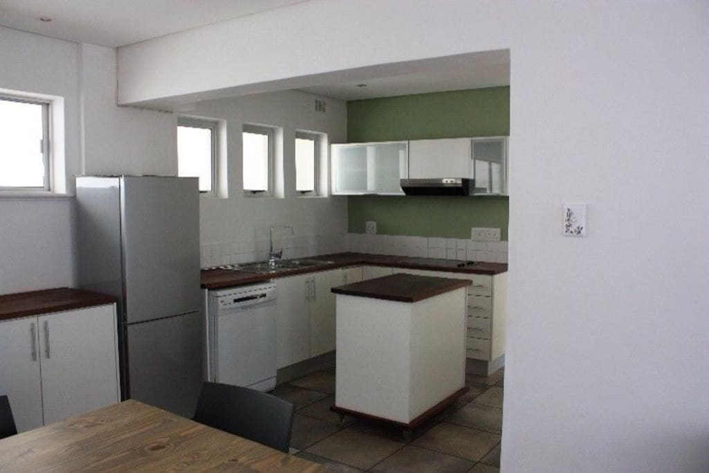 Fully equipped kitchen and 6 seater dining table