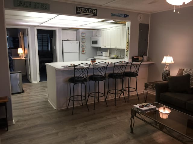 Brand new kitchen with all the appliances, large and small, you will need.  Plus a great eat at kitchen table with beautiful bar stools.