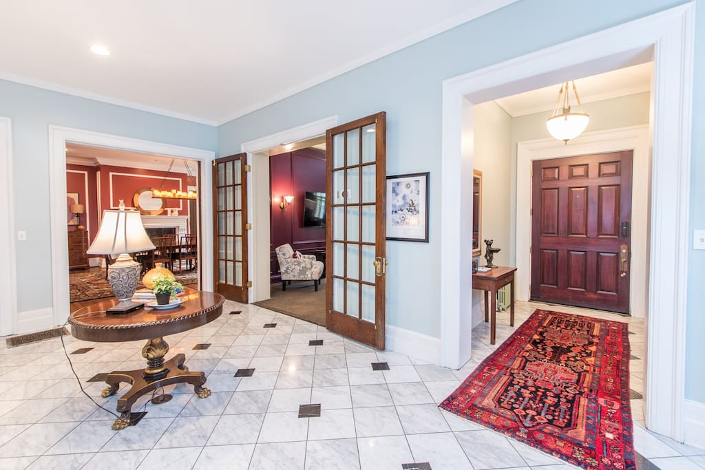 Grand foyer with 11' ceilings and original marble floors