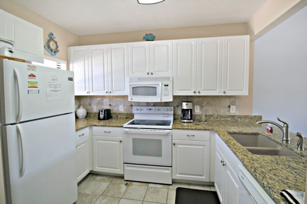 Well equipped kitchen with granite countertop