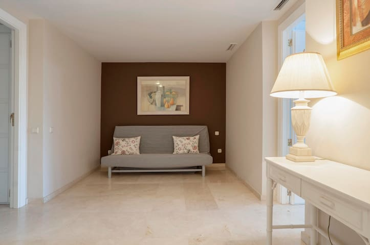The area between the 2 bedrooms which has a sofa bed.
