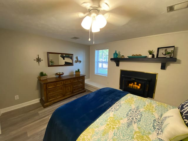 1 of 3 Queen bedrooms. This one has an electric candle fireplace