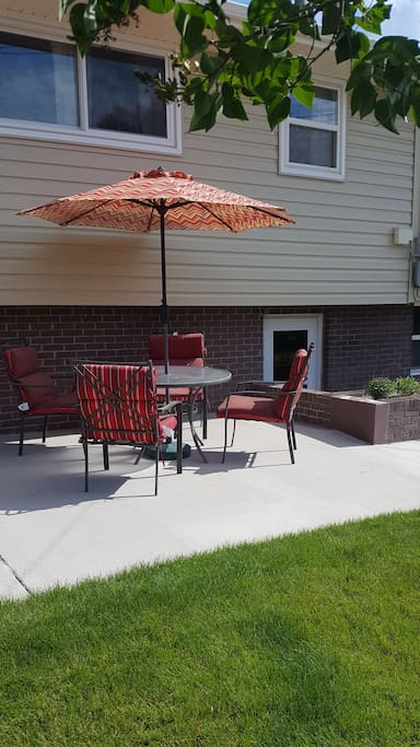 Spacious and colorful shared outdoor living space. Full yard, patio and sitting area, and private parking.