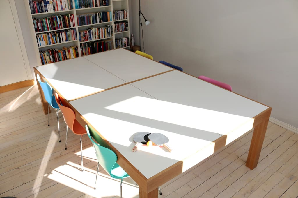 The dining table was custom built by a local designer and doubles as a competition-size ping pong table