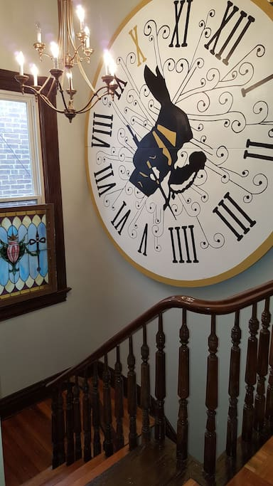 Beautiful stairwell with art & vintage stainglass found on Cherokee