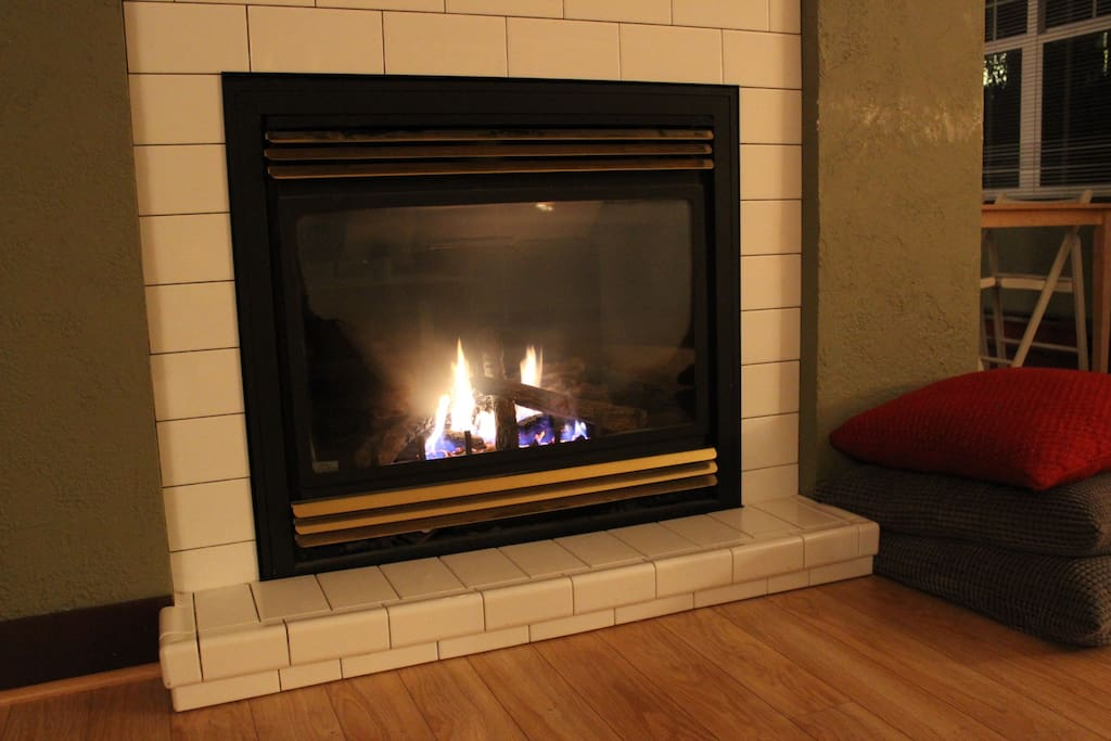 The living room features a large gas fireplace.