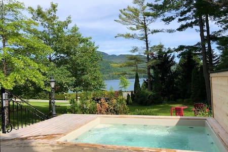 Villa Lac Orford, Bord de l'eau avec spa & sauna