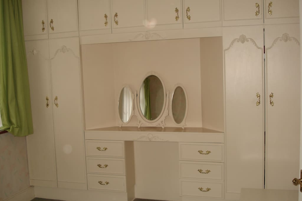 Wardrobe with mirror in bedroom