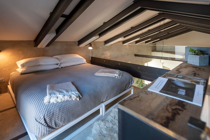 bedroom with king size bed on the mezzanine