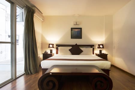 Bedroom in the cozy- 1BHK