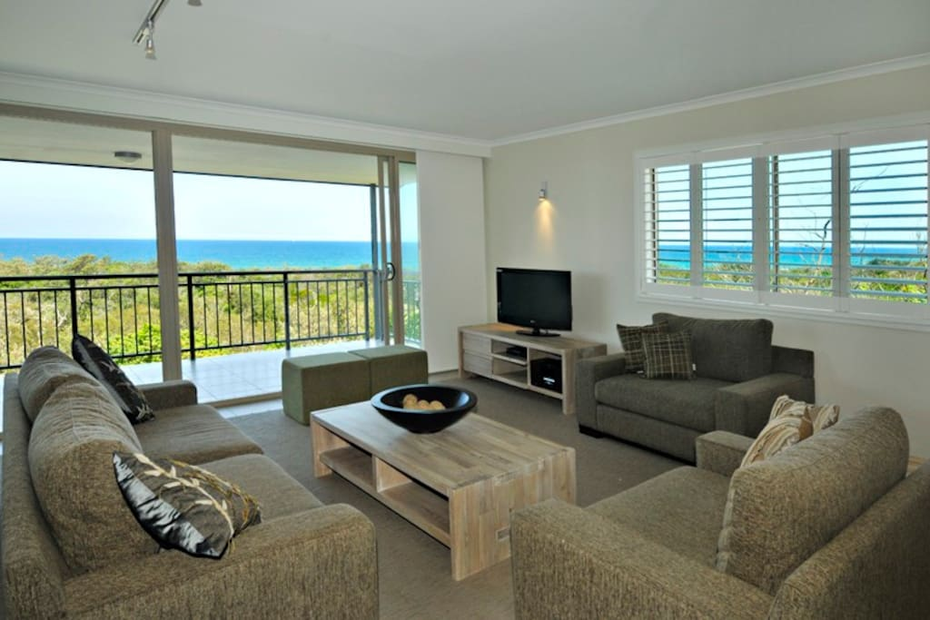 Living room with ocean views & access to balcony