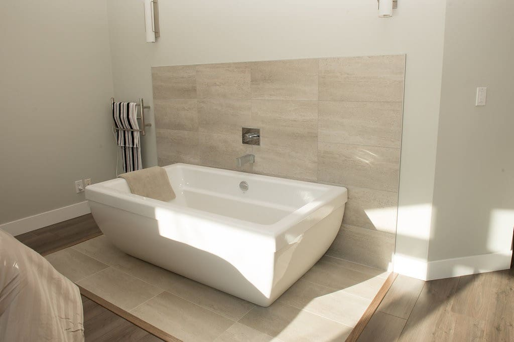 Private tub in master and heated towel bar.