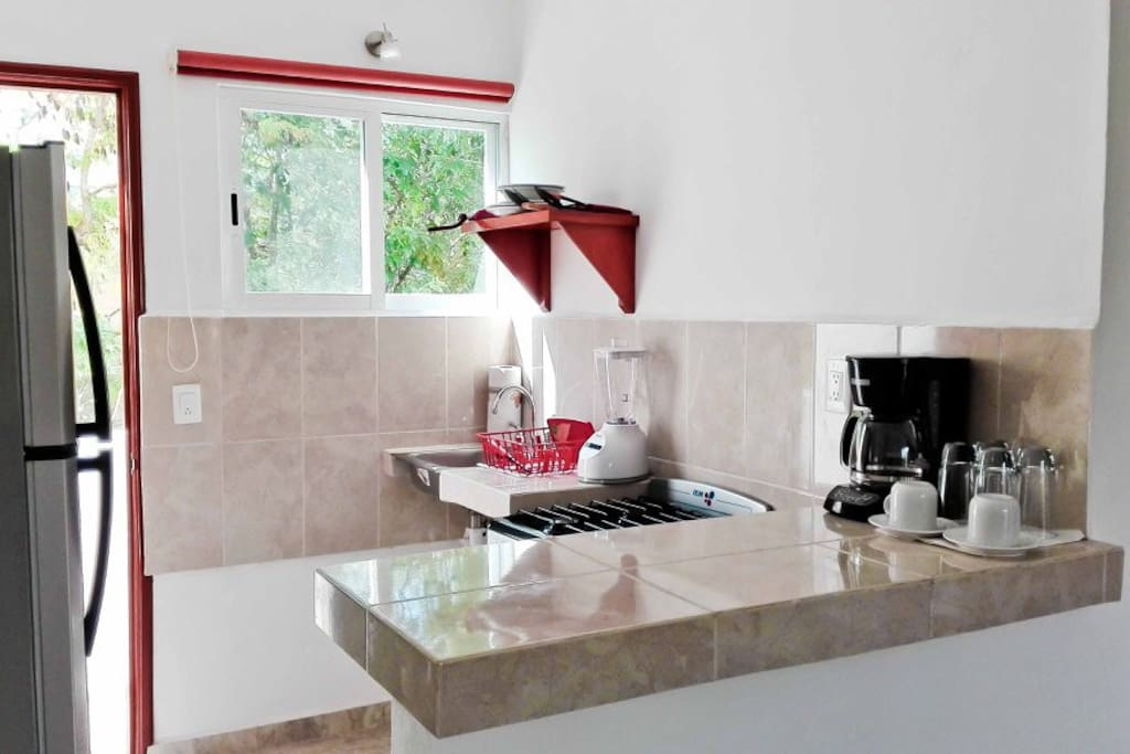 The kitchen has all the necessary dishes for cooking, coffee maker, mixed, gas cooker, big fridge with a freezer...