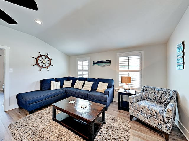 A sectional couch and armchair seat 7 in the living area.