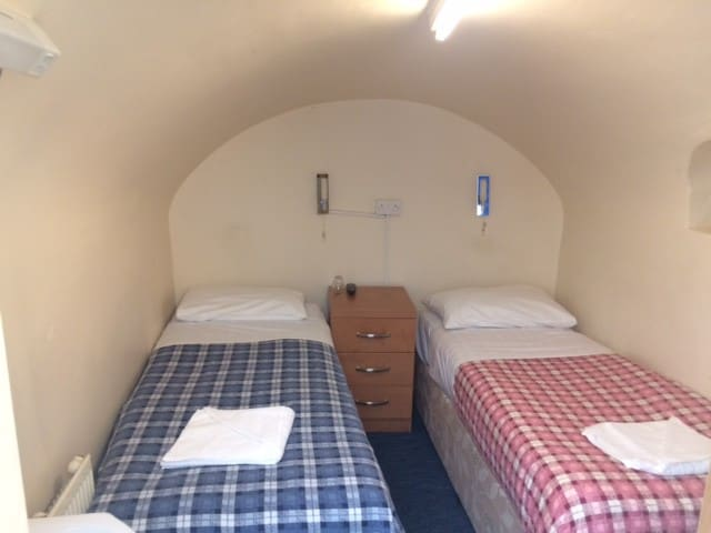 Cellar twin room with Shared Bathroom & Toilet.