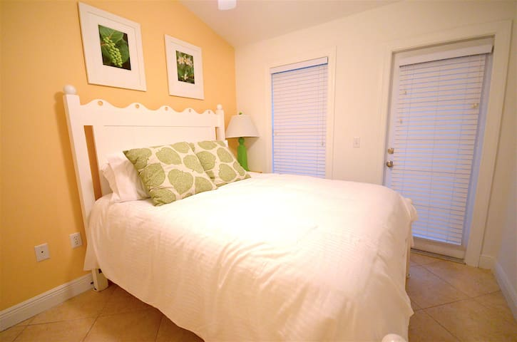 1st upstairs bedroom with a queen size bed