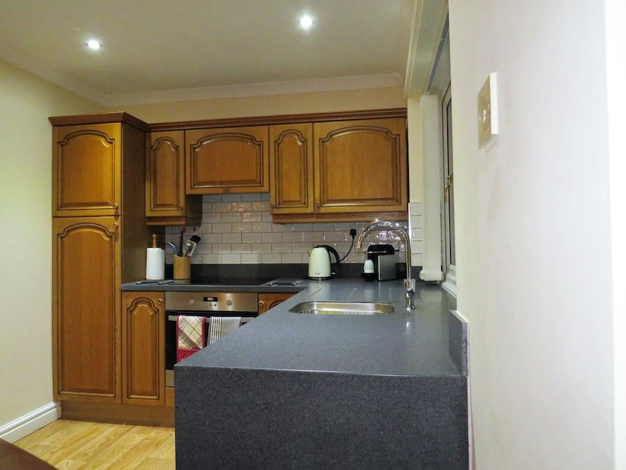 Fully equipped kitchen with induction hob, oven, coffee maker, toaster, kettle, everything you could possibly need