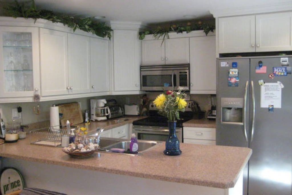 Kitchen with cookware, appliances & dishes, etc.