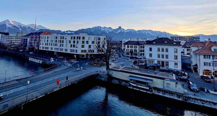 Space on the banks of river Aare and view of Alps
