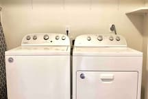 Washer, dryer, and ironing board provided
