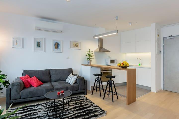 Living room, kitchen, wooden bar