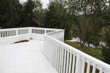 Private deck, overlooks the dock on the pond.   Canoes provided and fishing rods.