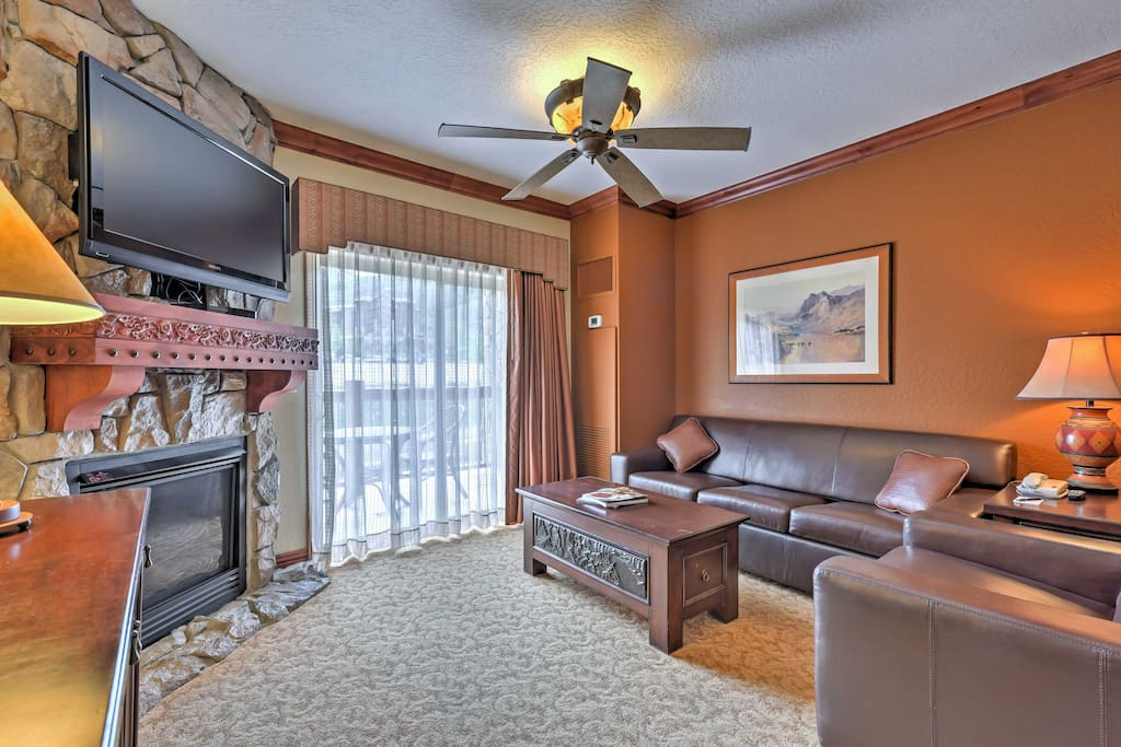 The cozy interior offers plush leather furniture and a gas fireplace.