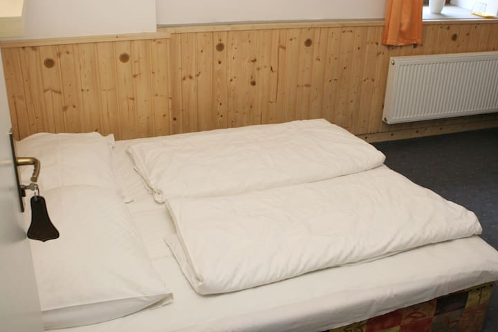 Room with a double bed and extra bed option