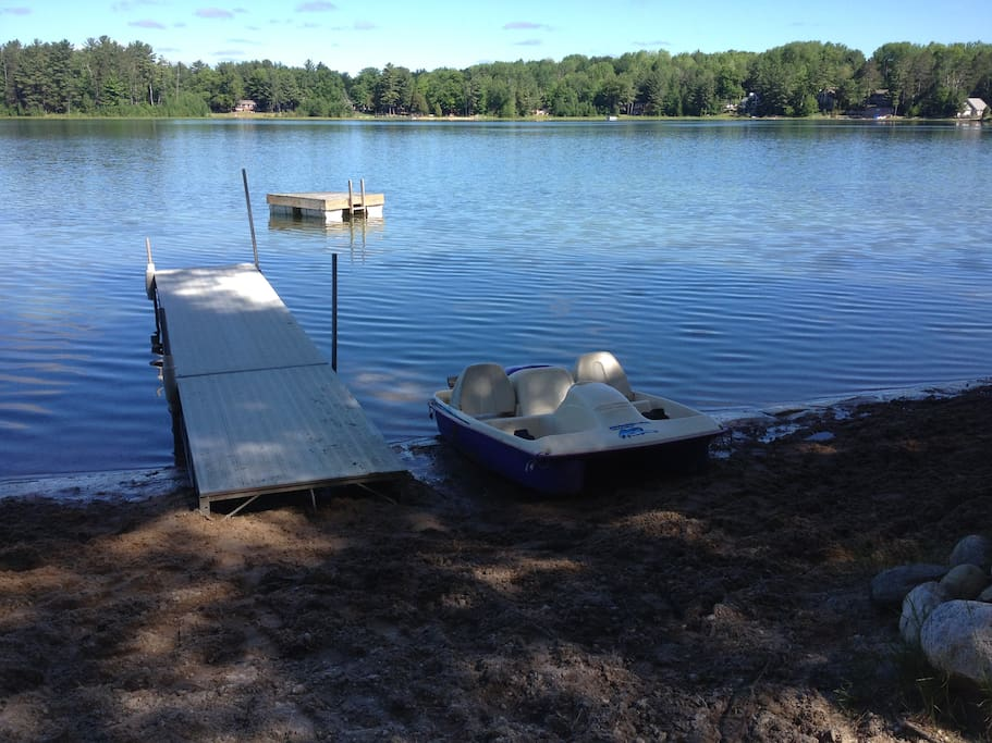 Private beach with dock, swim platform, paddle boat and two kayaks for you to enjoy!